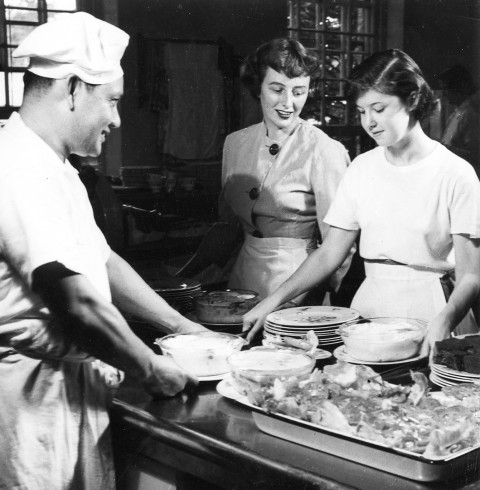 Meal time in Jane Addams House kitchen, 1949.