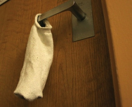 A sock on the door: the classic symbol of the sexile. Photo from web.